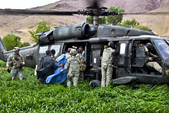 Helping patients in Uruzgan province, Afghanistan (The U.S. Army) Tags: mountain afghanistan field training soldier army military helicopter blackhawk usarmy patients uh60 uruzganprovince