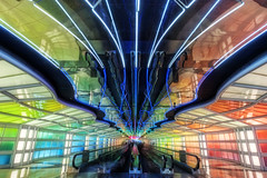 Time Warp (kern.justin) Tags: lighting chicago color photography high airport nikon neon dynamic time warp terminal symmetry ohare walkway helmut range hdr concourse jahn chicagoist d700 kernjustin wwwthewindypixelcom
