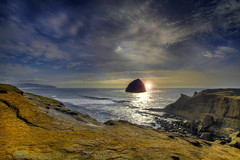 Sunset and Haystack Rock at Cape Kiwanda - Oregon - HDR (David Gn Photography) Tags: sunset sea sky seascape clouds landscape rocks pacificocean oregoncoast haystackrock hdr capekiwanda platinumheartaward canoneos7d sigma1020mmf35exdchsm