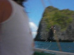 Island Hopping Boat Ride in El Nido (This World Rocks) Tags: trip vacation dan video southeastasia philippines alissa sanyo elnido palawan waterproofcamera sanyoxacti danandalissa sanyoxactivpce2 waterproofcamcorder