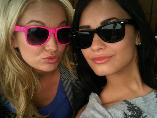 Tiffany Thorton and Demi Lovato doing hollywood tourist things (hahaha)