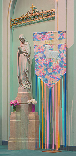 Immaculate Conception Roman Catholic Church, in Maplewood, Missouri, USA - statue of the Blessed Virgin Mary with Resurrection banner