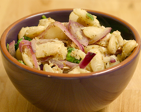 Warm butter bean, red onion, and spinach salad with mustard