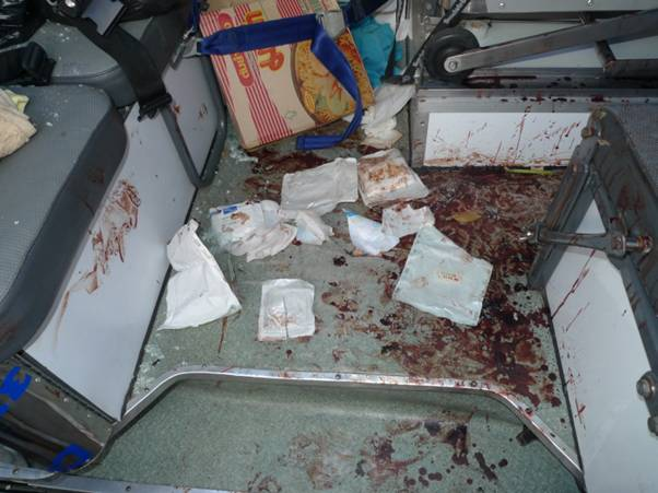 Blood spilling all over the rear area of the medic van due to massive loss of blood