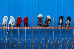 Drying shoes (), Hongju Nanjie, Xuanwu district, Beijing, China - Sunday, 23rd May 2010 (Lumire en juin) Tags: china blue sport fence construction rust gate shoes beijing rusty   spikes peking chine drying  pkin pechino  pequim