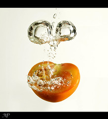 GO Tomato !! (|| Msh3L Alomran ||) Tags: white ex water vegetables fruit photoshop canon tomato drops tank background flash bubbles drop half bubble splash splashing splashes flashgun  cs5     meshal   alomran  1000d  430ii
