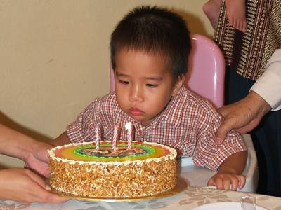 Julian blows candles