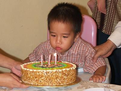 Julian blows candles