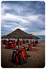 Ya mañana saldrá el sol... (InVa10) Tags: blue sea sky orange beach water azul clouds canon eos mar spain sand agua bank playa arena badajoz cielo nubes umbrellas naranja malaga orilla extremadura loungers sombrillas tumbonas inva 450d