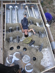 laying in our labor (fishermansdaughter) Tags: yurt cob floorheater heatingwithwood rocketmassheater unconventionalwoodstove cleanburningwoodstove selfbuiltstove