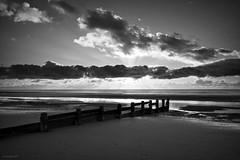 (andrewlee1967) Tags: uk sunset sea england sky blackandwhite bw silhouette clouds coast britain lancashire gb sunrays cleveleys sigma1020mm wavebreaker thorntoncleveleys andrewlee mywinners andrewlee1967 canon50d