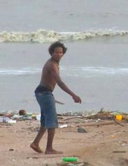 Surprise (Legin_2009) Tags: ocean sea shirtless man black male men guy beach trash walking garbage underwear walk african knife guys litter jeans barefoot topless males caribbean shorts sagging sag mec mecs