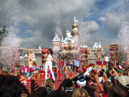 Selena Gomez performs in front of Sleeping Beauty Castle
