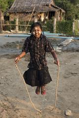 Myanmar 2017-38 (Trev Thompson) Tags: asia burma burmese child childplaying cosmetics culture ethnic girl happy lookingatthecamera myanmar people portrait skipping smiling streetscene thanakha ye mon