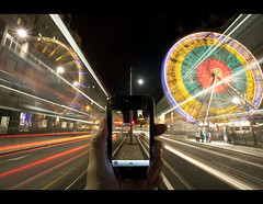 Picture in Picture (Chee Seong) Tags: longexposure carnival winter light moon bus edinburgh traffic trails princesstreet cano pole dri hogmanay iphone canon1740mm theedinburghwheel 5dm2
