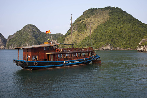 halong bay junk. A junk anchored amongst the Karst formations of Halong Bay.