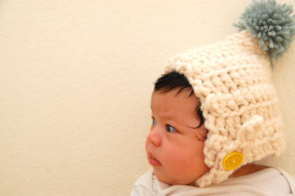 in her cozy hat