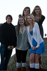 Five young girls were running and frolicking around Morro Rock