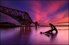 Forth Rail Bridge @ Sunset - Scotland (angus clyne) Tags: ocean camera uk longexposure bridge blue light sunset red sea sky orange cloud sun house mist seascape color colour reflection art beach home wet water yellow night clouds work canon river dark painting landscape island scotland pier boat crazy interesting fantastic colorful edinburgh europe waves sailing nightscape darkness purple harbour fife earth jetty magic dream scottish calm forth fantasy photograph anchor ripples setting magical girders ebb gloaming northeastsouthwest leefilters colorphotoaward firthforthrailrailwayroadbridge coastcoastlineshoreshorelineseashore circleringsquareroundpiperivetrivetedsteelpaintedvictorianweldweldedpaintpaintedconcretecementgirdergirdersspancrosscrossingflyoverneverendingalwaysworkingrailwaylinetracksthickthin rustrustedrustyrusting flightflyingtravel