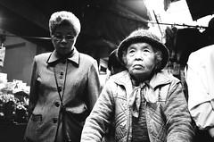 Two women. Taipei, Taiwan (deepstoat) Tags: street bw film 35mm taiwan yashicat5 kodaktmax400 bestoftaiwan deepstoat