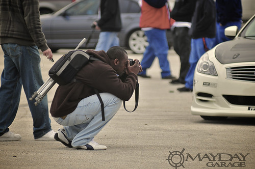 This photographer has all his gear with him at the ready.