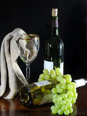 Wine and Grapes (floralgal) Tags: stilllife fruit wine alcohol grapes wineglass cocktails winebottles tabletopstilllife clothnapkin classicstilllife wineandgrapes wineandfruit wineglassandgrapes wineglassandnapkin grapesandwine dianaleeangstadtphotography