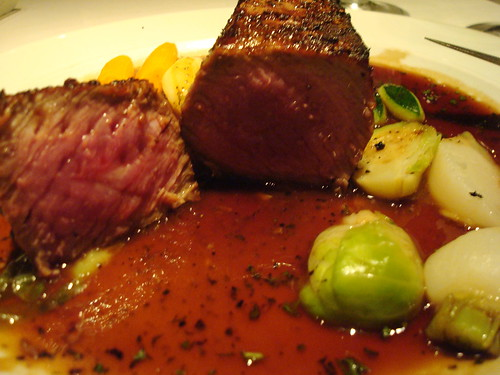 Opus' Canadian striploin with truffled vegetables and fine herbes jus