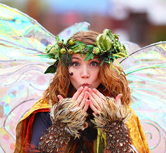 Twig the Fairy warming her fingers 2010 AZ Ren Fest! (gbrummett) Tags: green beautiful fun gold cool pretty medieval fairy twig renfaire renfair huzzah 2010 50v5f huzzar twigthefairy arizonarenaissancefestival azrenfest canonef135mmf2lusmlens grantbrummett canon5dmarkiidigitalcamera azrenfes 2010azrenfes royalfaire