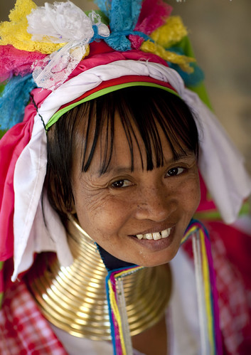 Long Neck woman smiling, Thailand. Kayan people , or long neck, are supposed