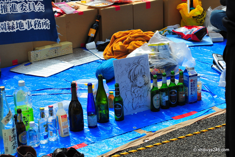The empty bottles are lined up, the drawings left behind. These guys are probably restocking and will be back soon.