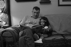 Reading with Paw-Paw (Starving Eyes Photography) Tags: family baby cute loving glasses book toddler daughter grandfather adorable curls read couch story granddaughter niece sit granddad cushion pinocchio pawpaw listen naiya