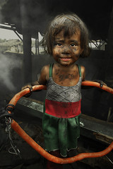 Children of Ulingan (Charcoal Factory), Manila - 'My Toy', Pic #3 (Mio Cade) Tags: poverty boy portrait white mountain black hot cute girl hoop children justice kid asia child brother labor smoke hula philippines environmental social dirty dirt burn charcoal manila smoky choke tondo ulingan
