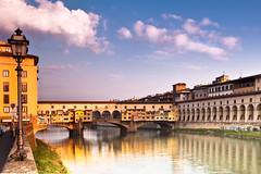 ponte vecchio at sunrise (Jared Ropelato) Tags: travel italy water sunrise canon river florence pontevecchio 5photosaday jaredropelato ropelatophotography