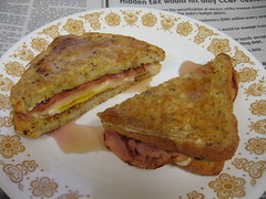 Ham, egg, and provolone stuffed French toast (with syrup)