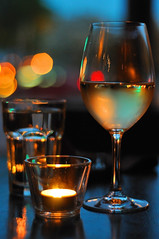 Spill The Wine (herecomesanothersongaboutmexico) Tags: dinner candle wine bokeh wineglass whitewine tabletop downtownminneapolis votivecandle minneapolismn spillthewine wowiekazowie