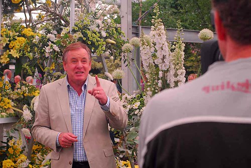 Chelsea 2010 - Australian television films a link with the NFU's gold-winning stand in the background.