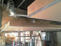 Suspended bulkhead construction using raw X-Board Kraft