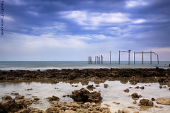 i Miss Clouds (A.alFoudry) Tags: blue winter sea sky seascape reflection beach water rain birds rock clouds canon landscape eos rocks slow mark smoke tide low pipes pipe full filter shore lee frame shutter land 5d after lowtide kuwait fullframe scape effect kuwaiti 2010 q8 abdullah  mark2  gnd  || kuw q80 q8city xnuzha alfoudry  abdullahalfoudry foudryphotocom hevyclouds mark|| 5d|| canoneos5d|| mk|| canoneos5dmark||