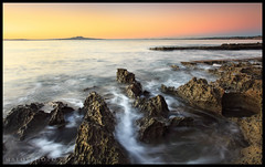 Rock Mellon (Mark Emirali) Tags: ocean light sea newzealand sun seascape blur colour detail art nature water sunrise canon landscape flow island volcano rocks mood auckland northshore elements nz aotearoa rangitoto longbay copyrighted longexpsoure 1740f4l pleasedonotusewithoutmypermission maloe4 5dmark2 5dmii maloephoto maloephotography markemirali markemiraliphotography