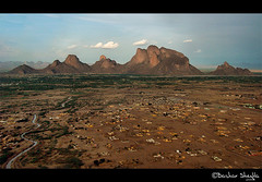 The City Under The Mountains ! (Bashar Shglila) Tags: city sky mountains clouds river view sudan gash an aerial taka     kassala       awitla