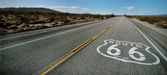 The Route 66 logo is painted on this segment of classic road near Essex, California (Greg - AdventuresofaGoodMan.com) Tags: california road usa classic rural america emblem route66 highway mother roadtrip crest 66 route interstate essex motherroad