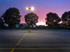 the color of truth is gray. (icolorinthelines) Tags: new york pink blue trees light sunset sky ny yellow purple empty parking stripe lot line rochester simple cloudslightningstorms