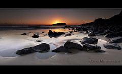 Spending the Morning Fishing off the Rocks (danishpm) Tags: orange seascape beach sunrise canon sand rocks fishermen au australia wideangle lowtide aussie aus 1020mm manfrotto sigmalens cookisland rockfishing eos450d fingalheads 450d tweedshire dragondaggerphoto dragondaggeraward sorenmartensen tweedarea hitechgradfilter 09ndreversegradfilter peregrino27newvision
