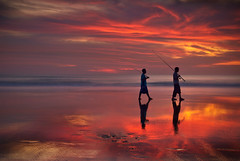 Seminyak sunset (Helminadia Ranford(Traveling)) Tags: sunset bali color reflection beach indonesia fisherman seminyak