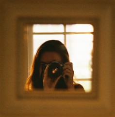 166. FRAMED. (Cherokeetribe) Tags: camera reflection girl framed sunflare