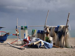 Hazy-Blue Thoughts and Ritual Suicide. Fishing Nets Drying on Sanur Beach, Bali, Indonesia (Rana Pipiens) Tags: suicide 1001nights colonialism groningenthenetherlands puputan legongdance mywinners flickraward ishflickr denpasarbaliindonesia lombokindonesia sanurbaliindonesia treasonoflombok ninyomanpollok blinkagain kutabaliindonesia srikomalaship regencyofbadungbaliindonesia mbrostvantonningen adrienjeanlemayeurdemerpres