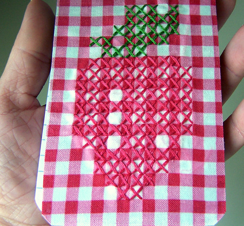 Notebook with cross stitched strawberry on gingham