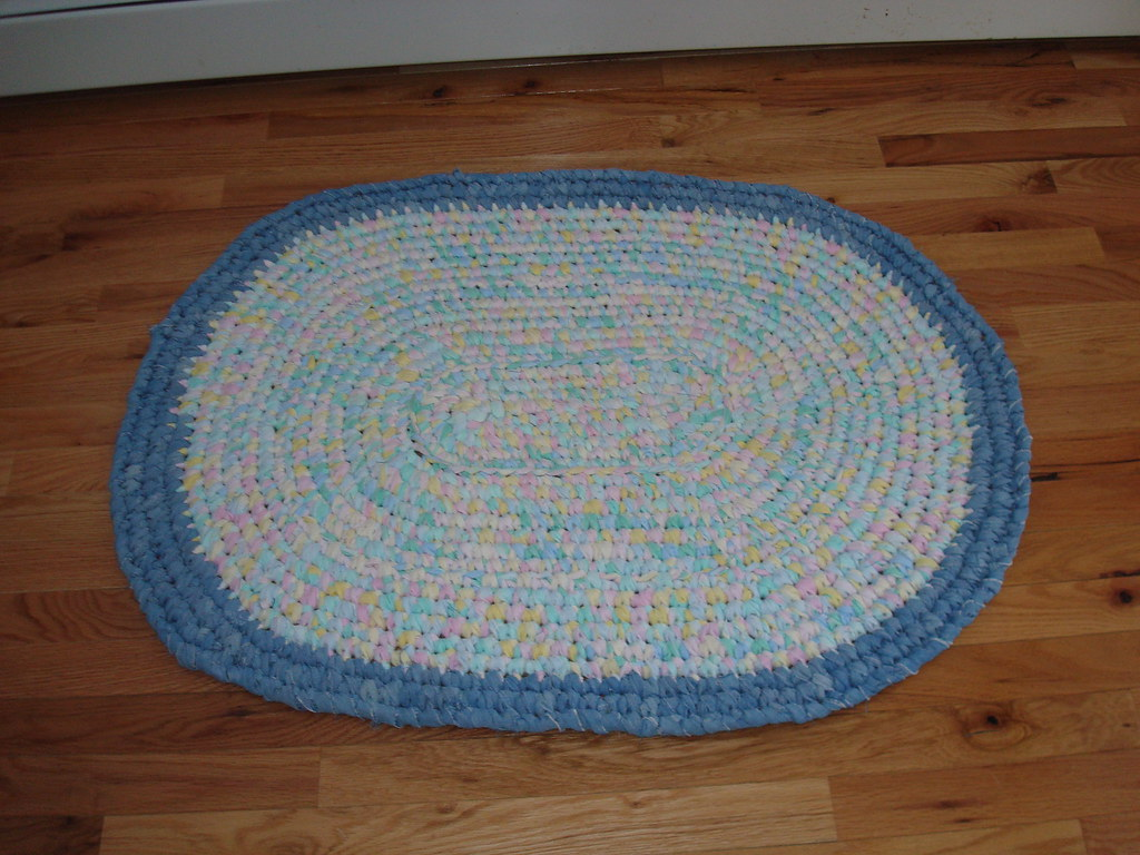 Baby girl crocheted rug from flannel and denim.jpg