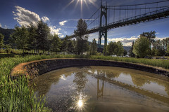 St. Johns Bridge from Cathedral Park - Portland Oregon - HDR (David Gn Photography) Tags: sky reflection clouds oregon portland landscape afternoon pdx hdr sunflare stjohnsbridge cathedralpark canoneos7d sigma1020mmf35exdchsm