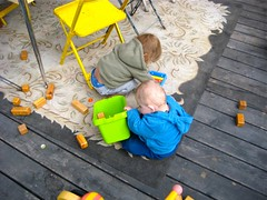 Boys playing on porch in Curlew